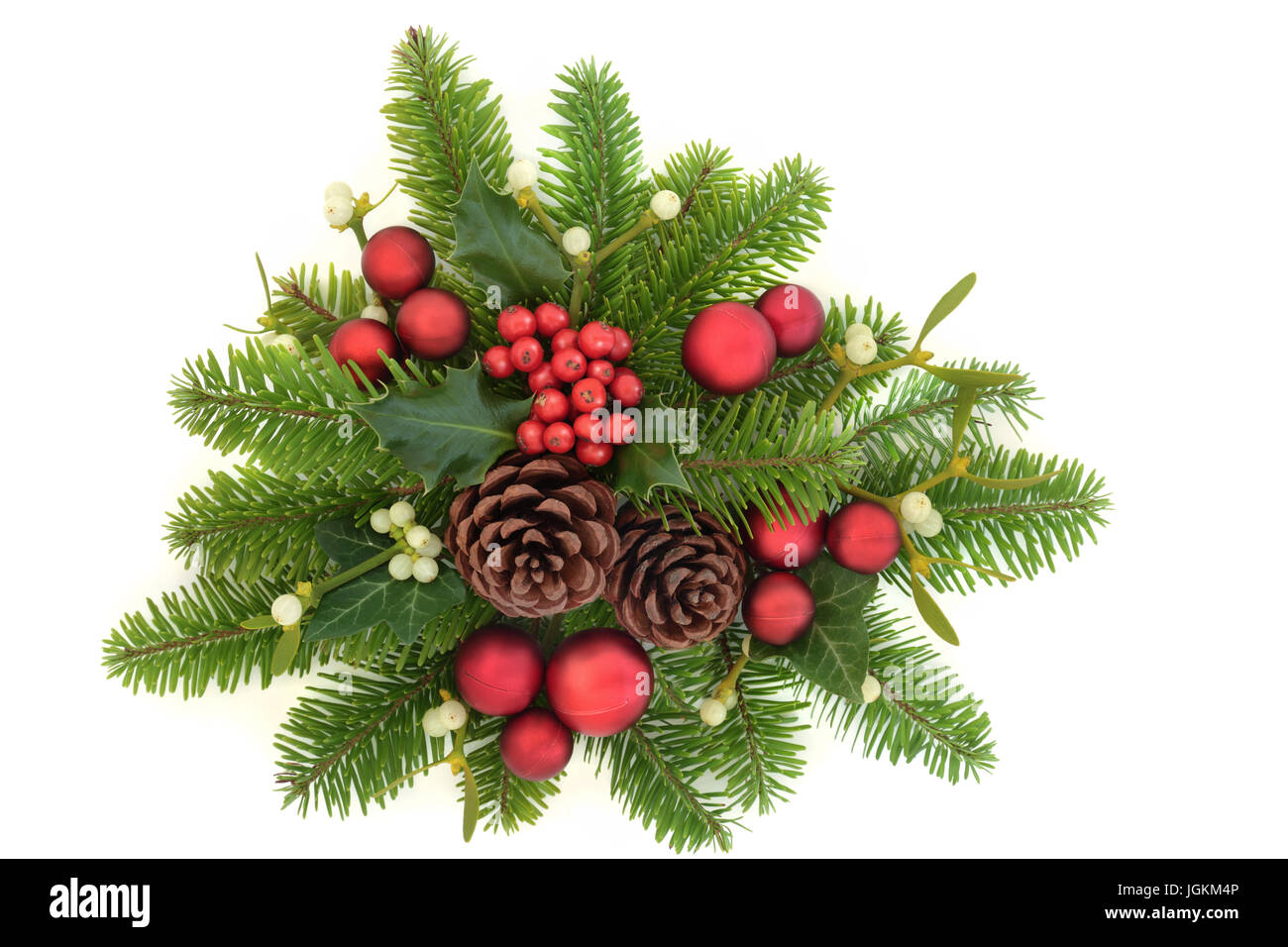 decorative christmas display with holly ivy mistletoe fir red