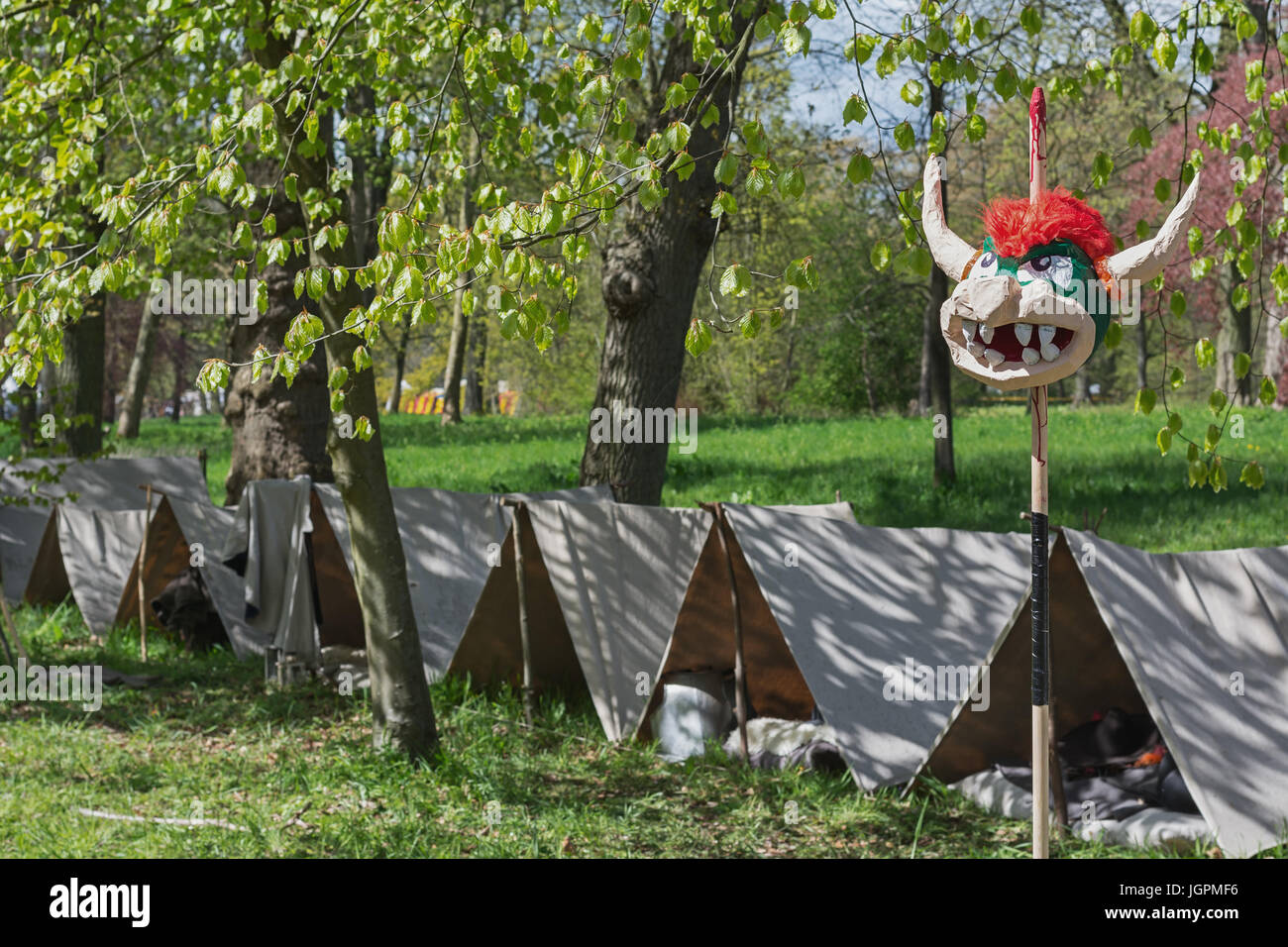 Simple tents on the festival site with in front an impaled bullhead of papier mache & Simple tents on the festival site with in front an impaled ...