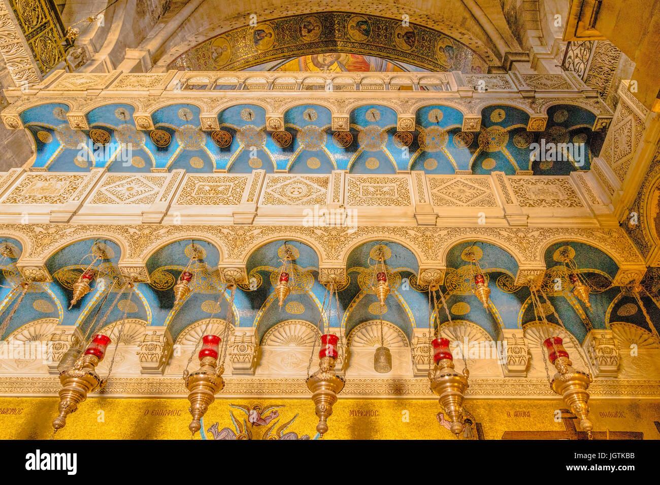 Gilded decorations and colorful mosaics on the interior walls in the ...
