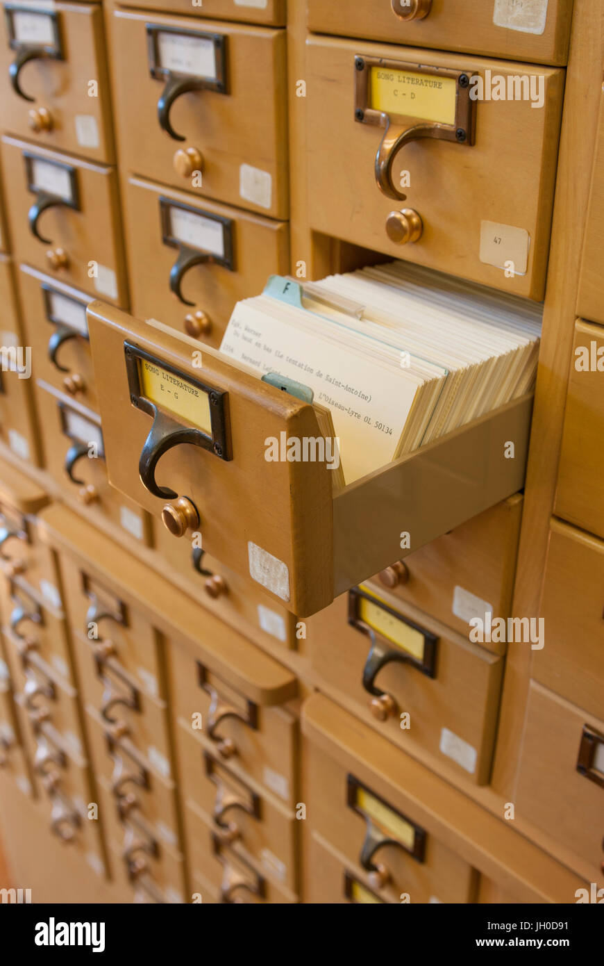 A wooden drawer card catalog in a library using the Dewey Decimal ...