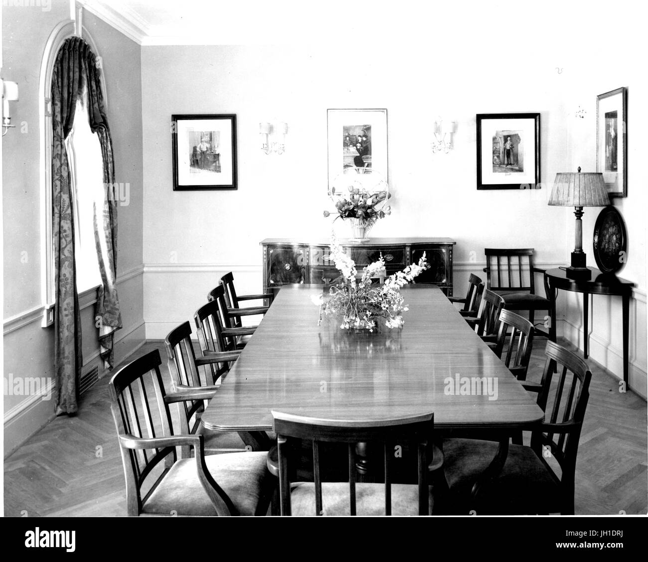 Dining Room Of The Johns Hopkins Club Featuring A Large Table Chairs Cabinet Framed Photographs And Sconces In Baltimore Maryland 1930