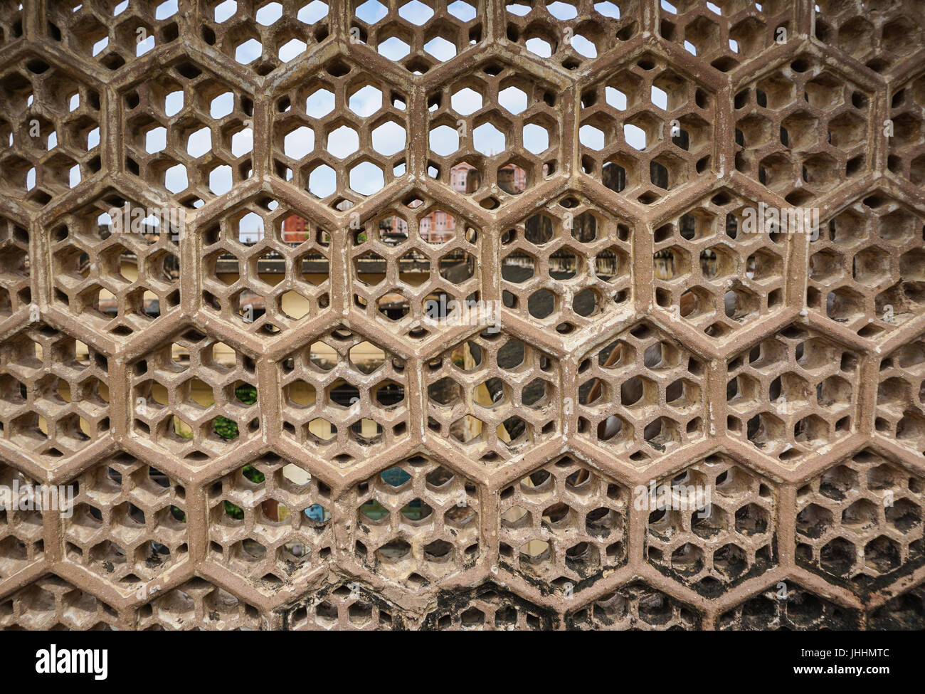 stone louver with window at the ancient castle in jaipur, india