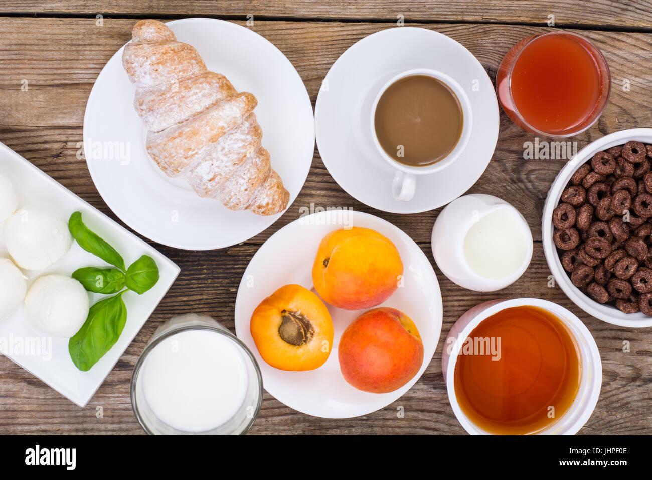 Breakfast table setting with chocolate flakes, mozzarella, juice ...