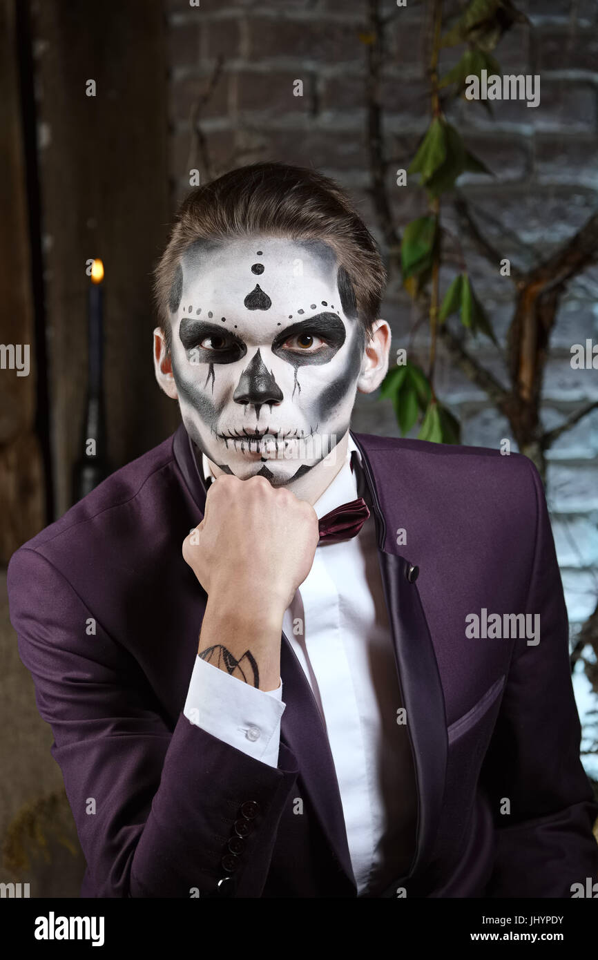 male sugar skull makeup face painting art stock photo