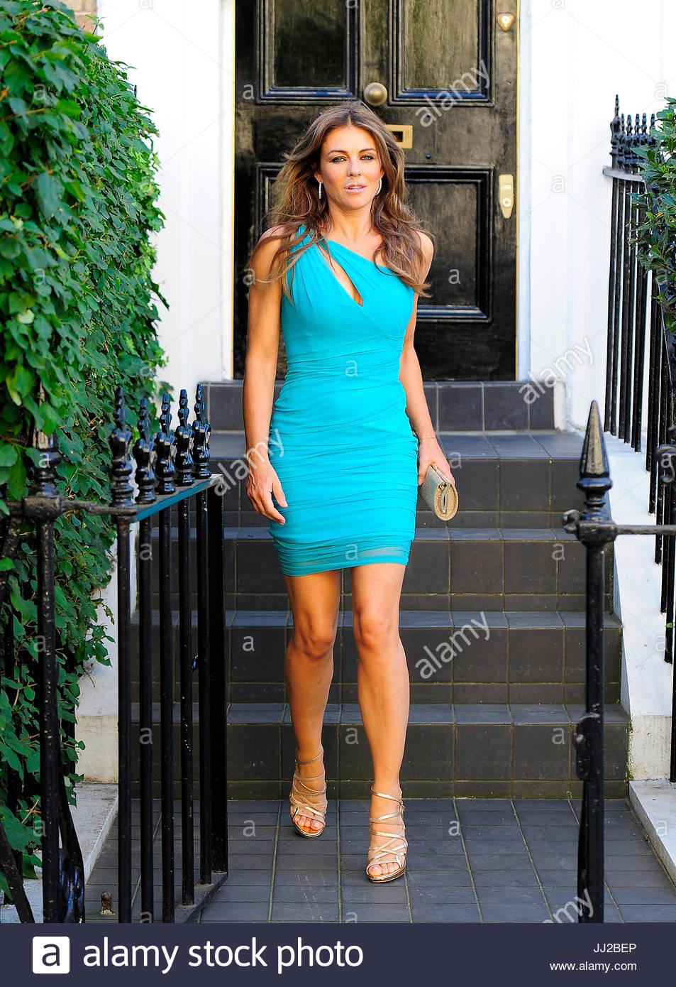 Liz hurley versace dress - Liz Hurley Liz Hurley Wearing A Blue Versace Dress Seen Leaving Her Home With Her Son