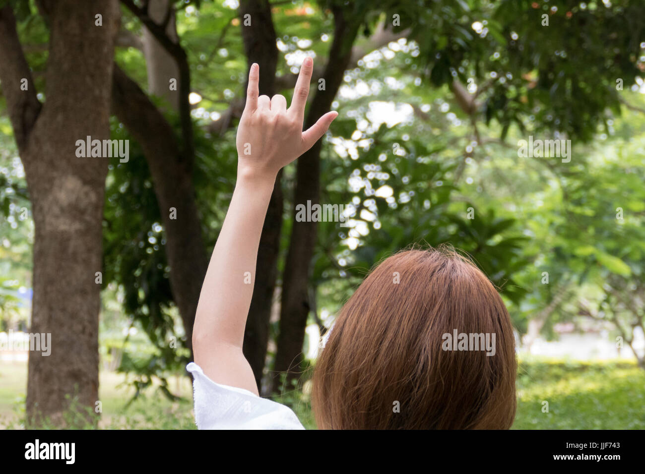 Female hand with i love you finger gesture woman showing symbol female hand with i love you finger gesture woman showing symbol sign language in the park biocorpaavc
