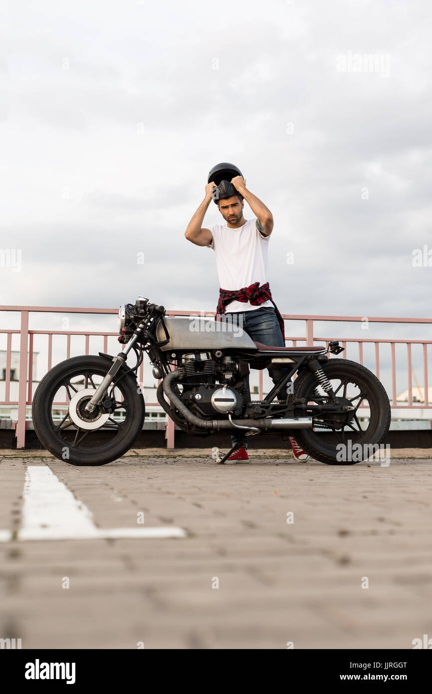 Handsome Happy Rider Man With Beard And Mustache Put On Black Moto