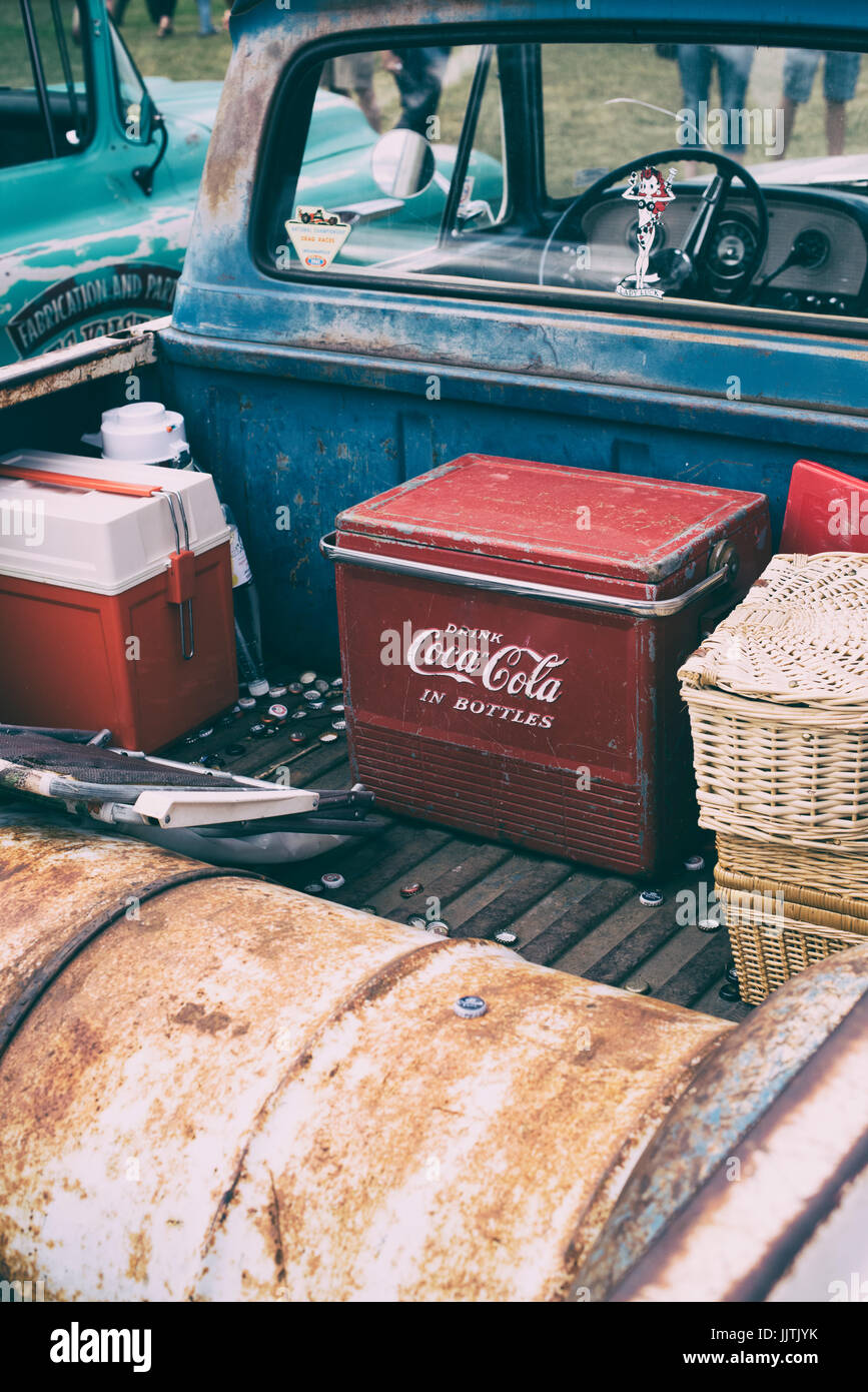 Old retro Coca Cola cool box in the back of a vintage american ...