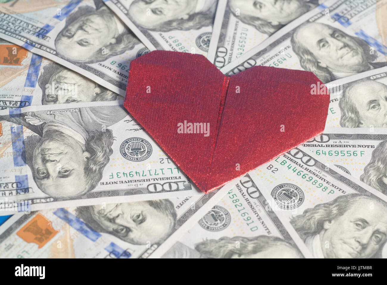 Red paper heart origami and hundred dollar bills for background red paper heart origami and hundred dollar bills for background jeuxipadfo Images