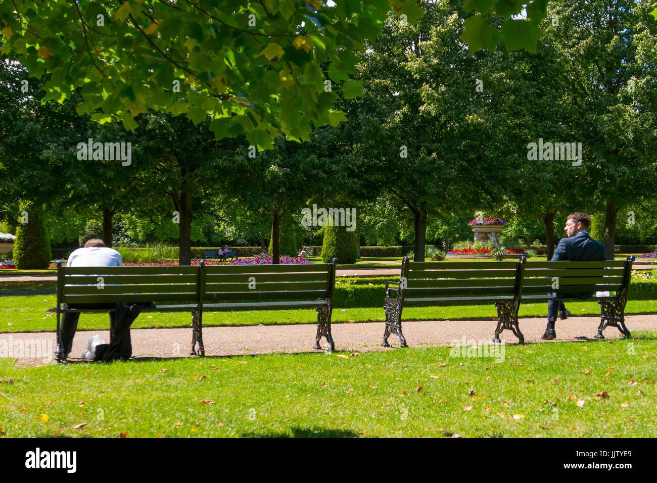 men sit on parks benches summer in the regent 39 s park london stock photo 149295169 alamy. Black Bedroom Furniture Sets. Home Design Ideas