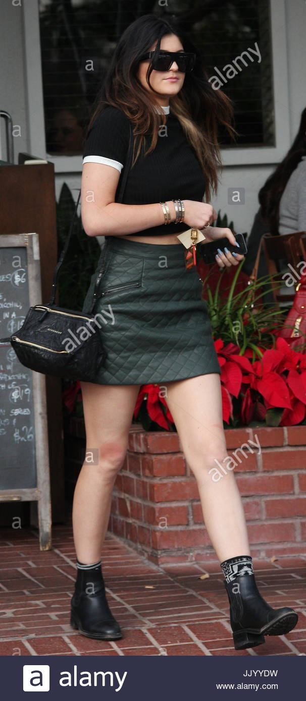 kylie jenner. kylie jenner looking very mature in a green leather