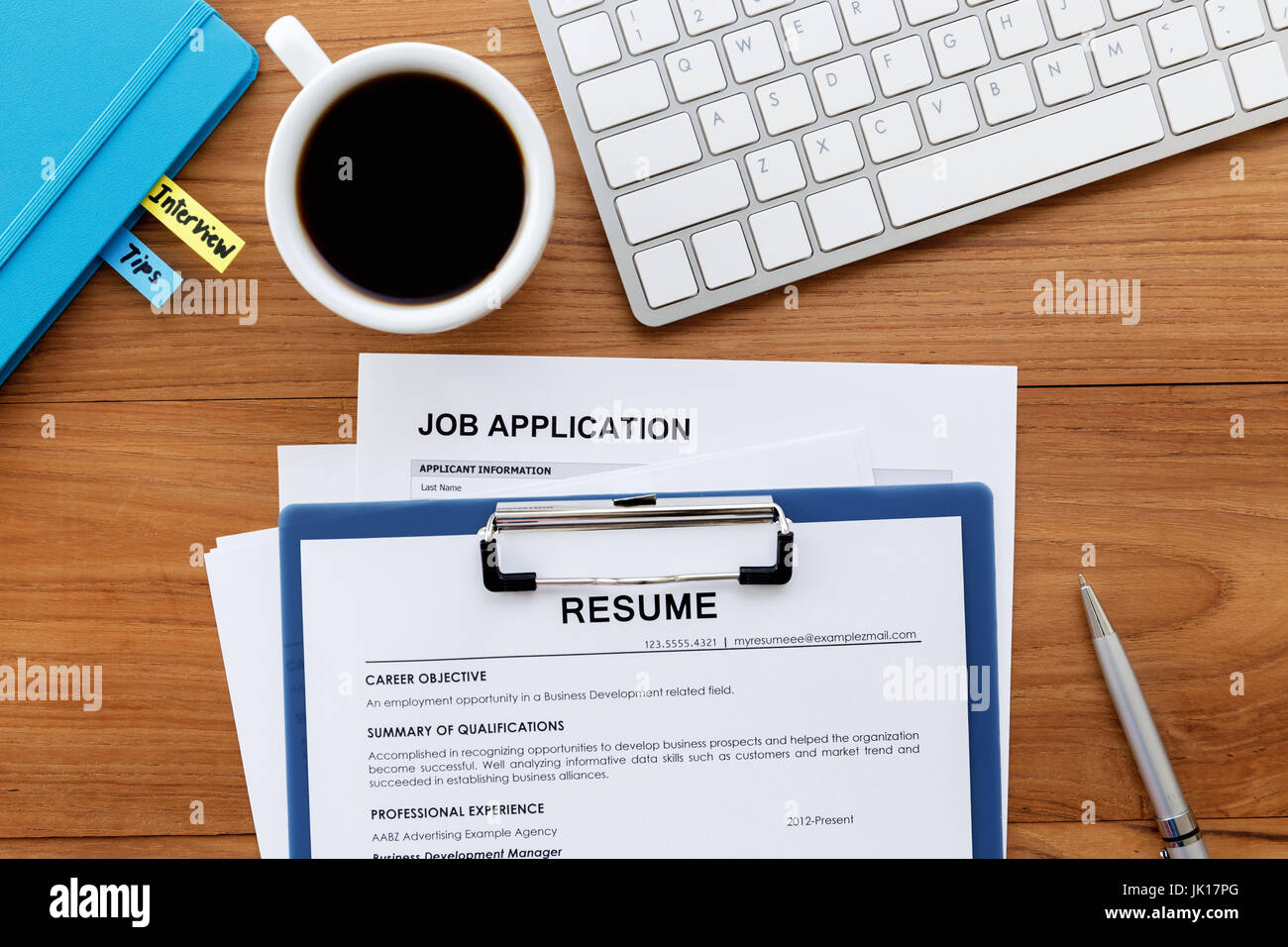 Job search with resume and job application on computer work desk ...