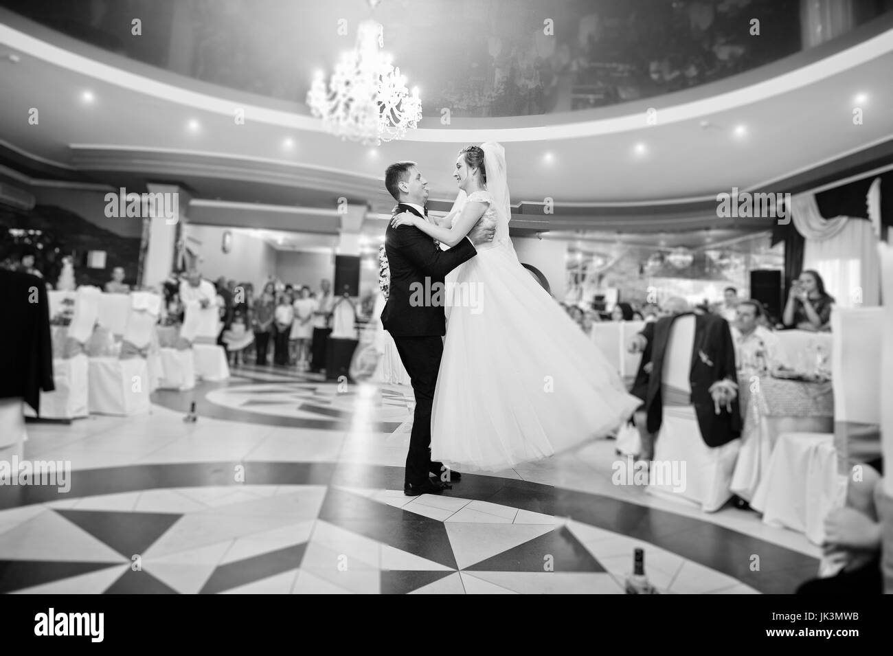 The First Dance Of Newly Married Couple At Their Wedding Party In Restaurant Black And White Photo