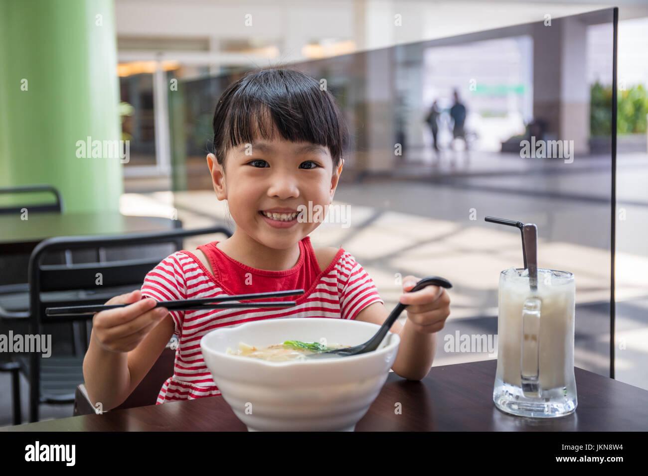 Asian girl eating noodles