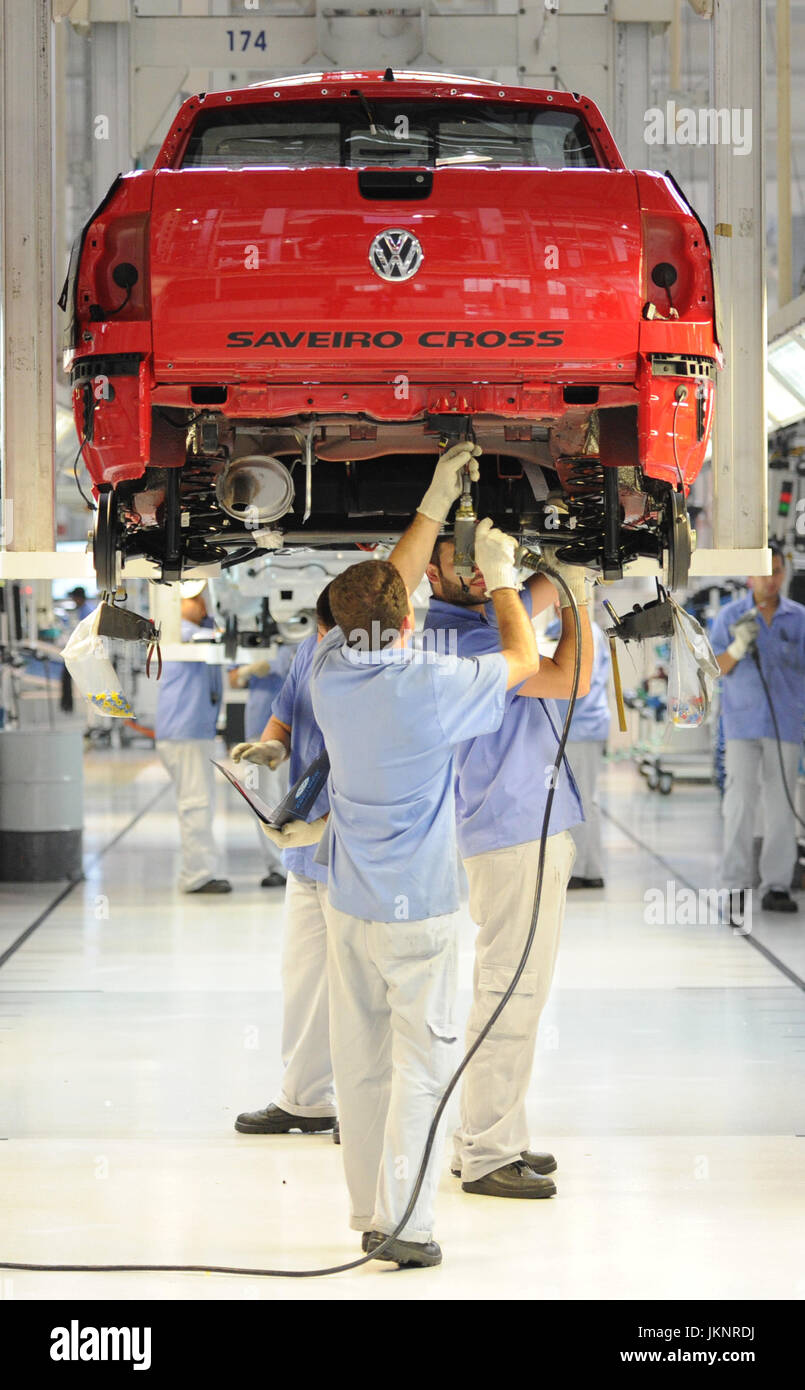Saveiro cross search pictures photos - Workers Stand Underneath A Vw Saveiro Cross On The Assembly Line At The Volkswagen Assembly Plant Anchieta In Sao Bernardo Do Compo Near Sao Paulo Brazil