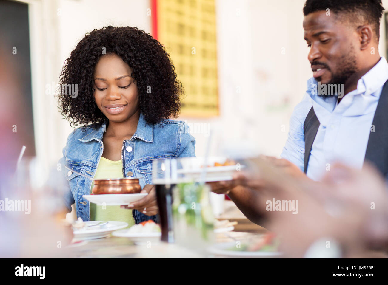 Happy Man And Woman Eating At Restaurant