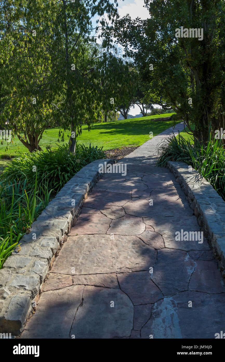 stone bridge flagstone walkway landscaped garden far niente stock