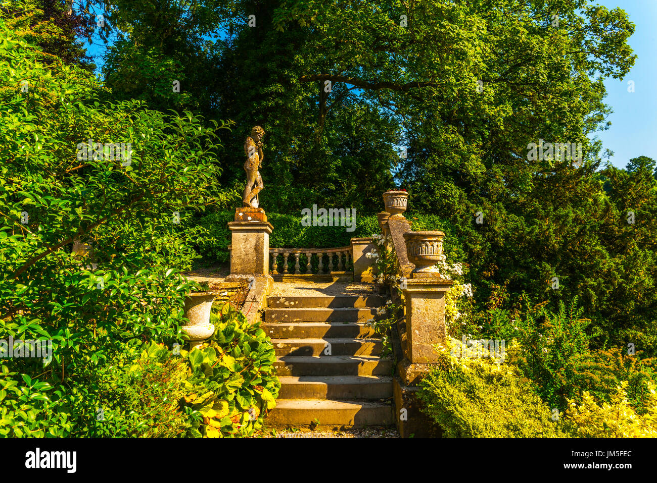 Beautiful stone stairs leading up to the garden, old decorative ...