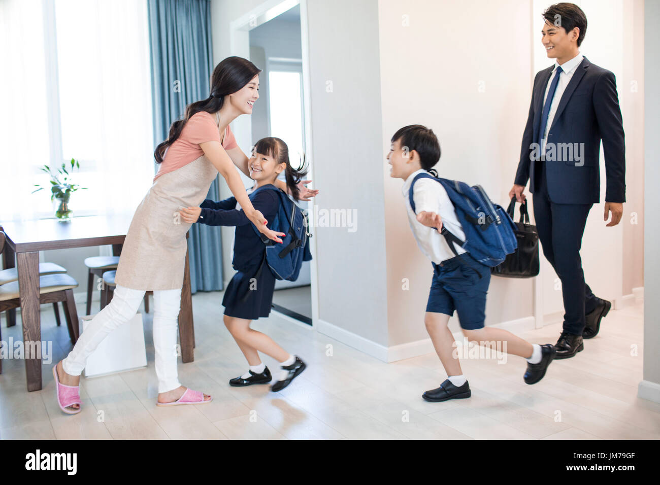 happy chinese children come back home from school stock photo