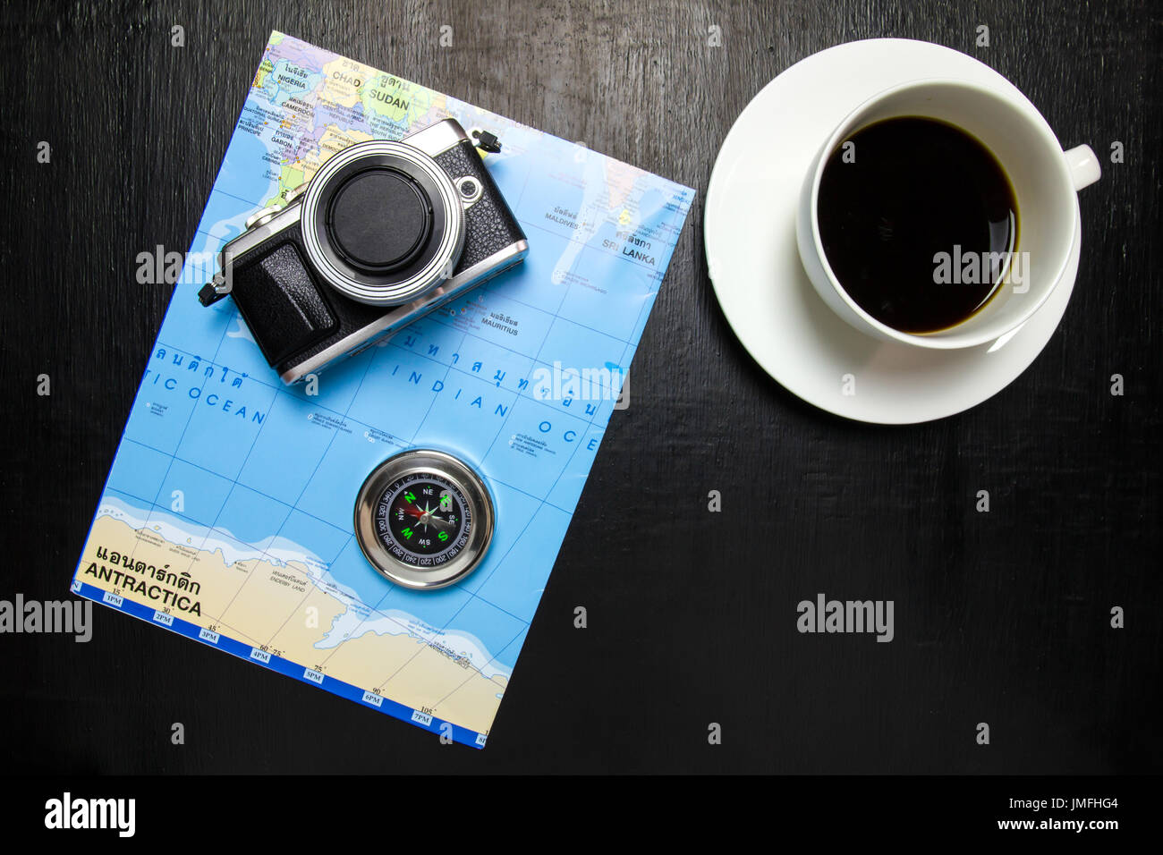 Top view of office desk workspace with coffee cup camera world map top view of office desk workspace with coffee cup camera world map compass on wooden background gumiabroncs Images