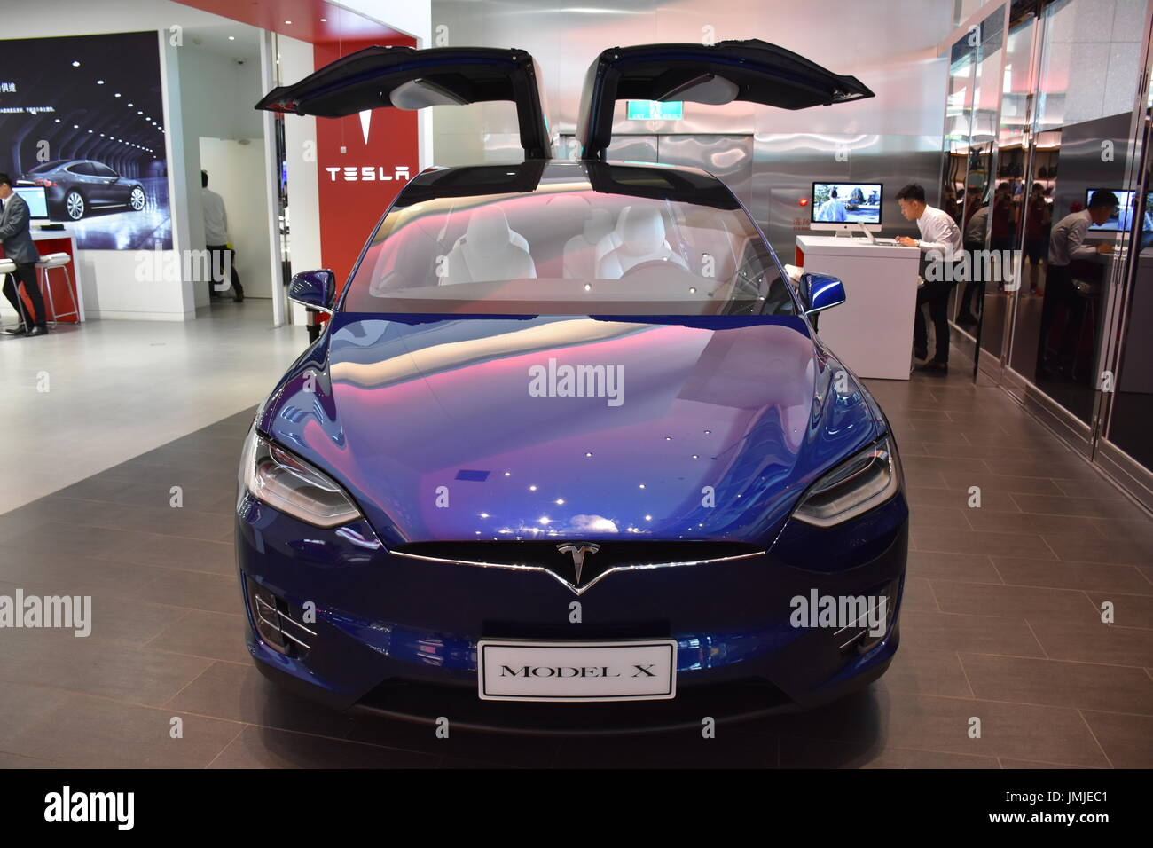 Tesla model x front view of its gull doors plates and symbol of a tesla model x front view of its gull doors plates and symbol of a car in a taipei taiwan show room 2017 buycottarizona Gallery