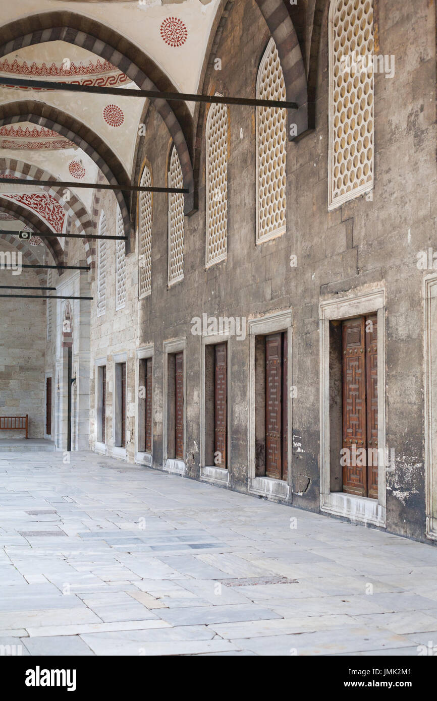 Arched ceiling Portico with doors in a row in the courtyard of an ancient mosque & Arched ceiling Portico with doors in a row in the courtyard of an ...