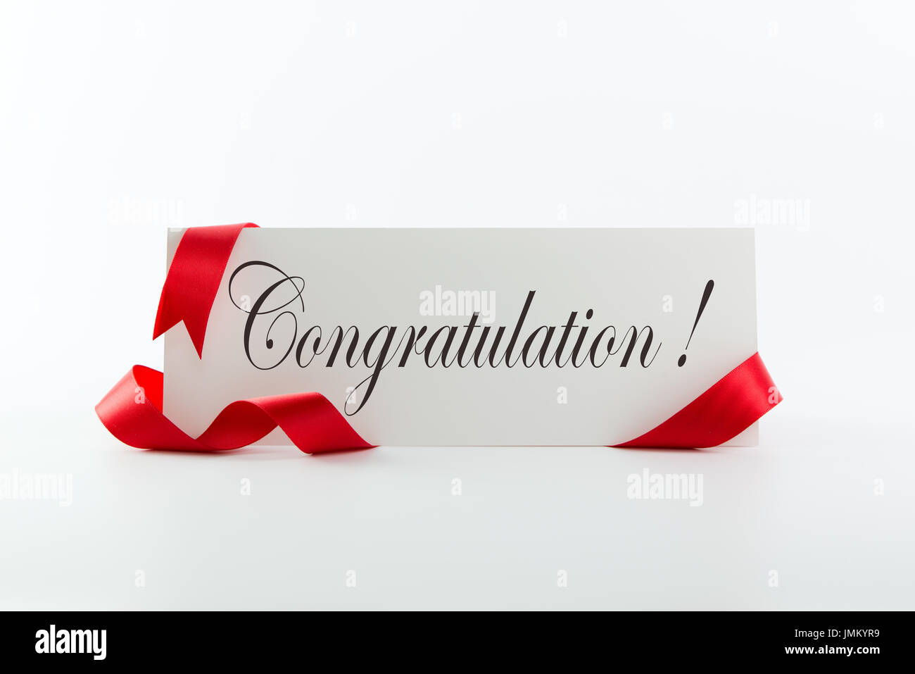 congratulations note or greeting card with red ribbon over white