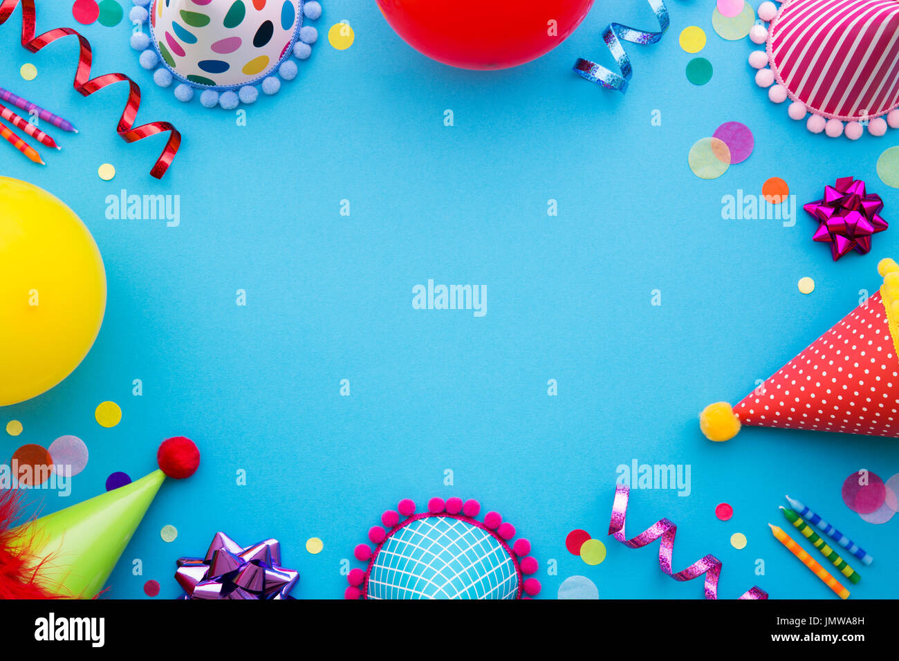 birthday party background with party hats and streamers stock photo