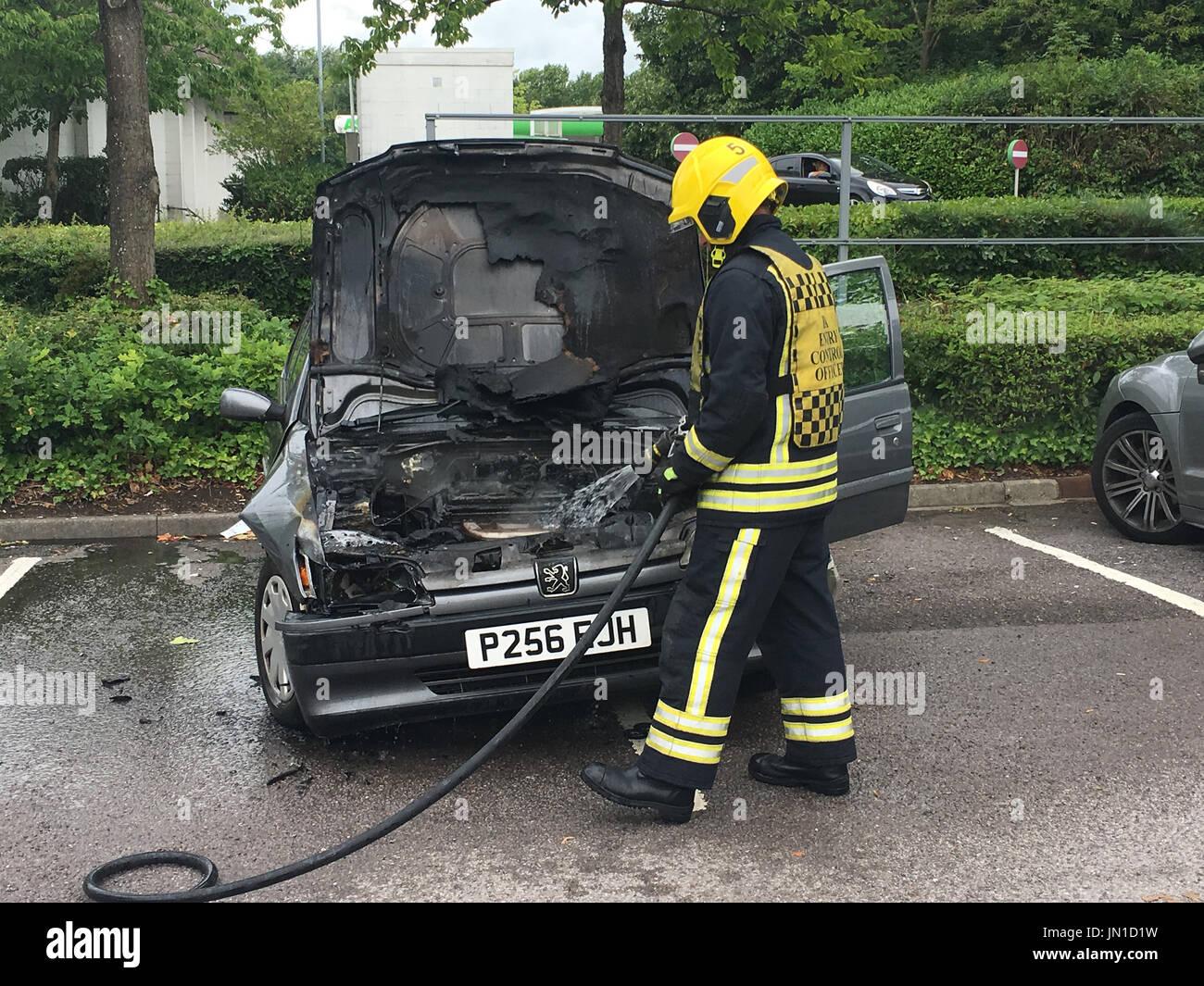 swindon, uk - july 29, 2017: car fire asda west swindon, firemen