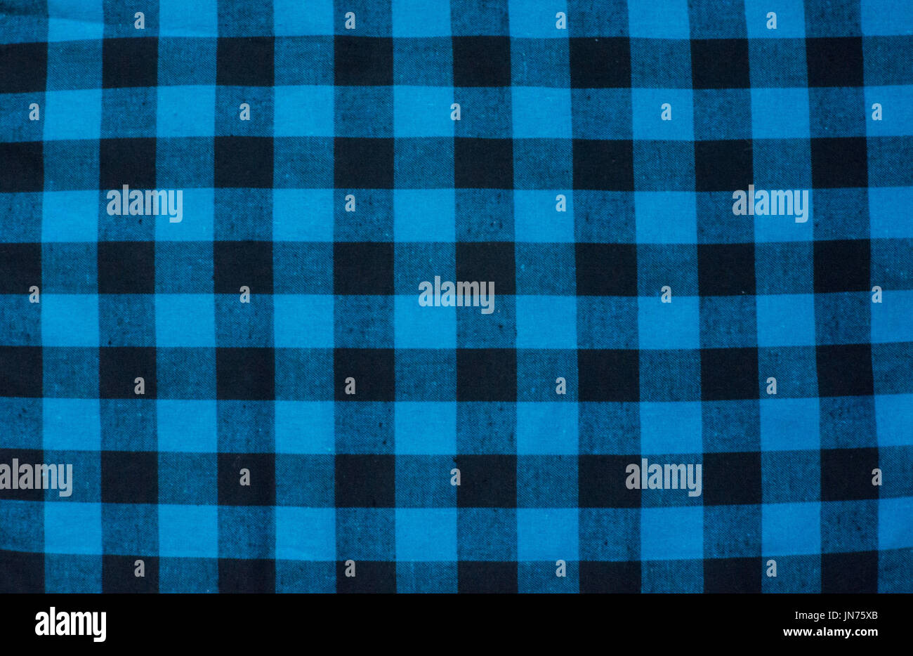 Blue Checked Fabric Tablecloth. Blue Black Cloth In A Cage In The Background