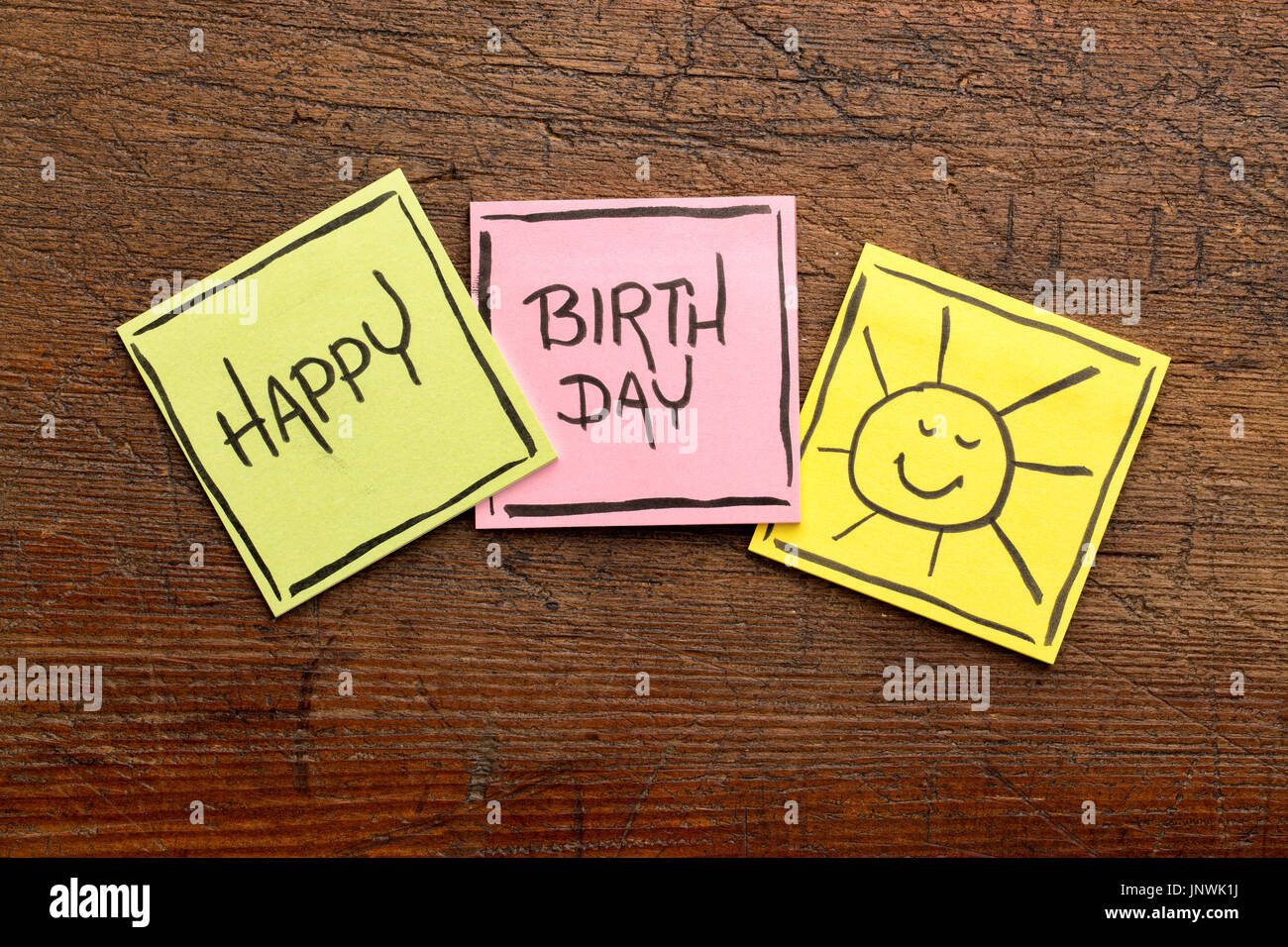 Happy birthday greeting card or banner handwriting on sticky happy birthday greeting card or banner handwriting on sticky notes on rustic wood kristyandbryce Choice Image