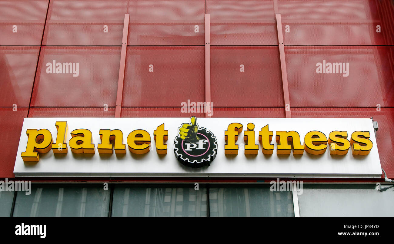 Fitness logo stock photos fitness logo stock images alamy sign above the entrance to a planet fitness gymnasium in manhattan stock image buycottarizona Choice Image