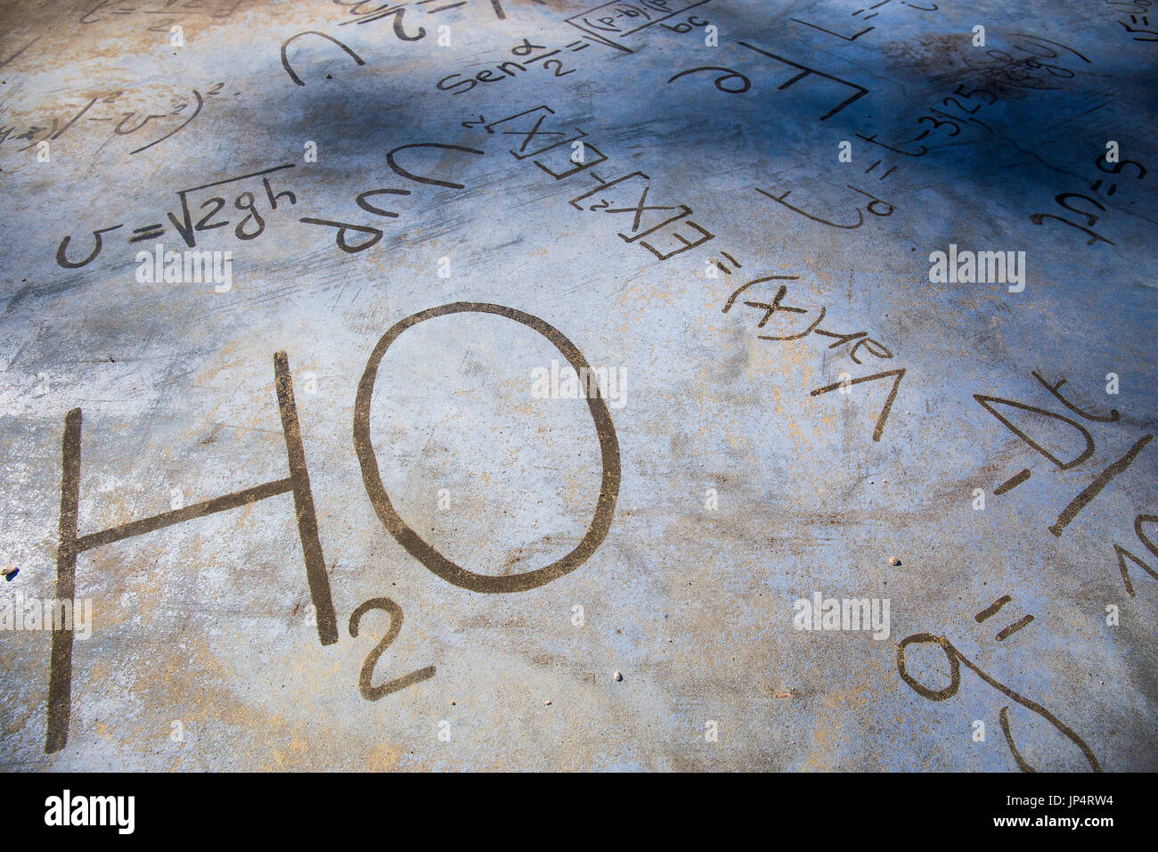 H2o chemical symbol stock photos h2o chemical symbol stock images chemical equations on a stone pavement h2o stock image buycottarizona Choice Image