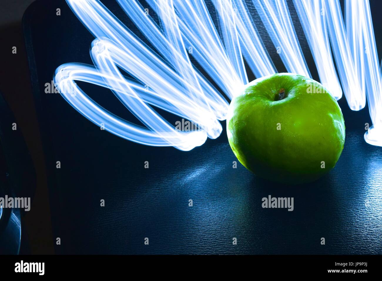 Green Apple Geometric Shape Stock Photos Green Apple Geometric - Fruit provides light for long exposure photographs