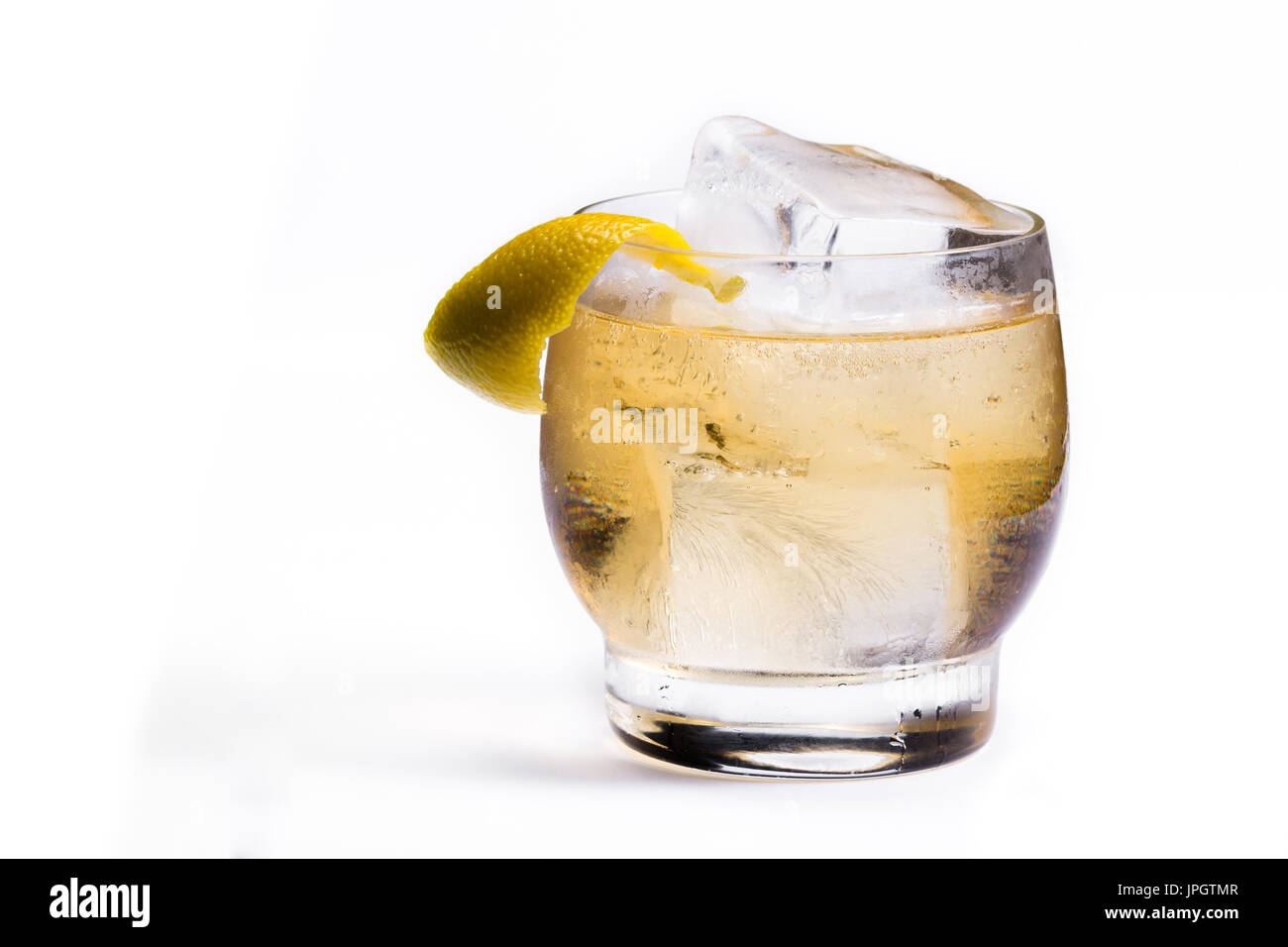 refreshing scotch and soda served on the rocks with a lemon twist