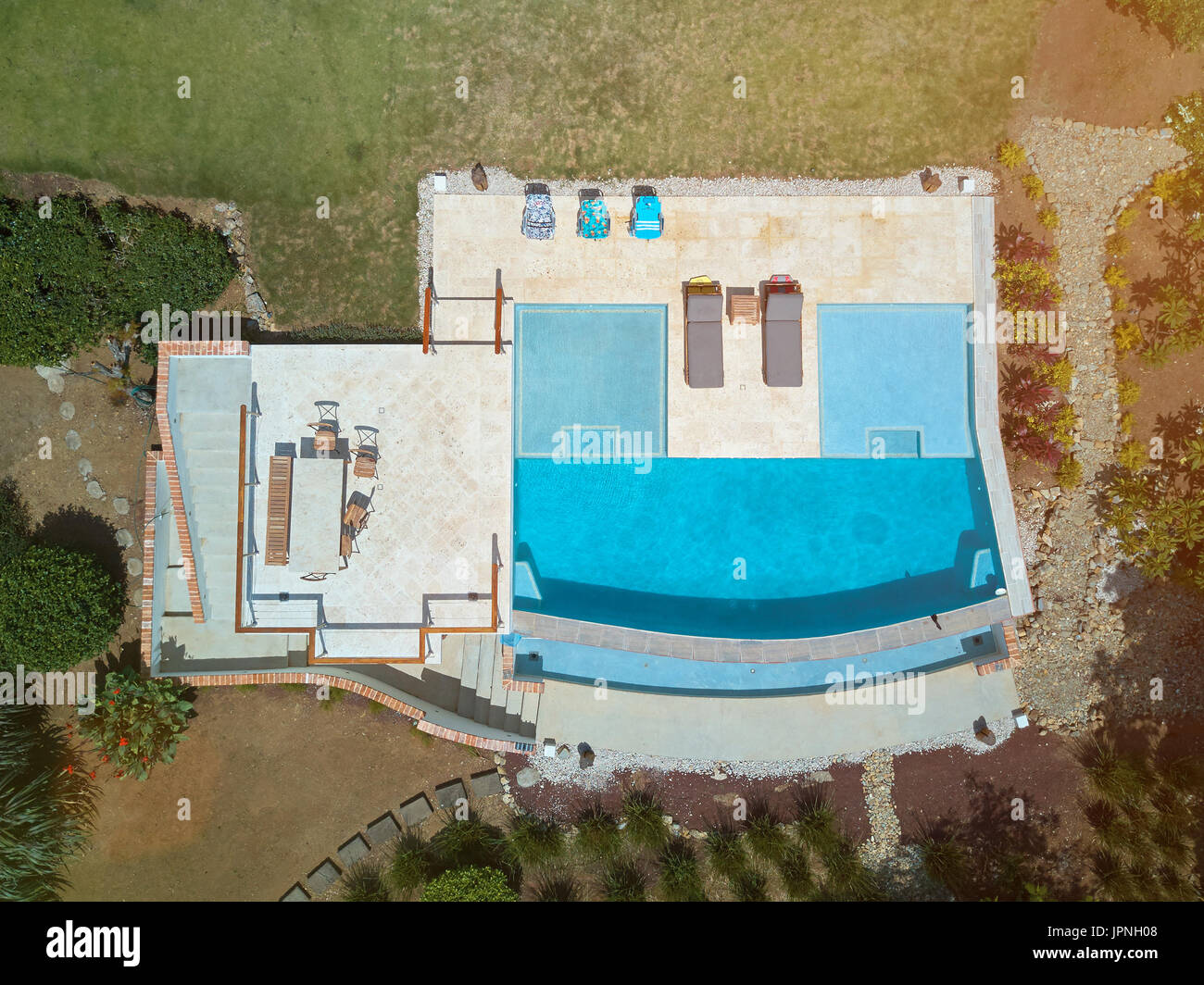 Pool with seats and chairs above top view from drone Stock Photo ...