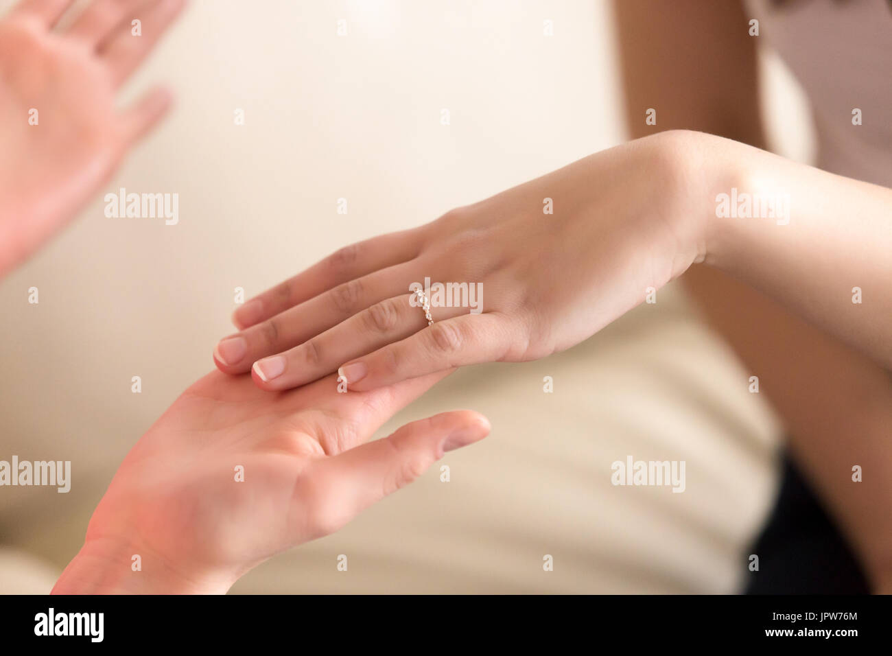 Image of female hand with ring on fourth finger Stock Photo Royalty