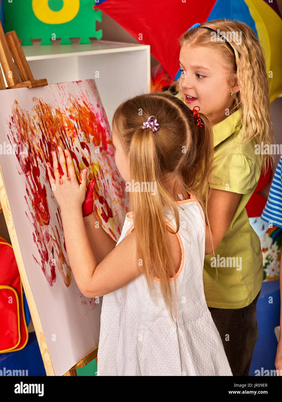 children painting finger on easel group of kids learn paint