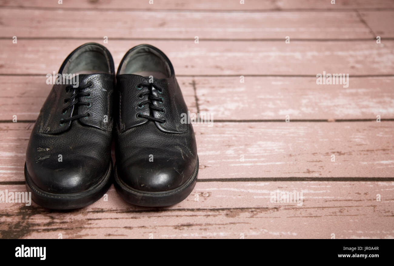 e2c395bd Old Black Dress Shoes on a Wooden Floor · Pamela Maxwell / Alamy Stock Photo