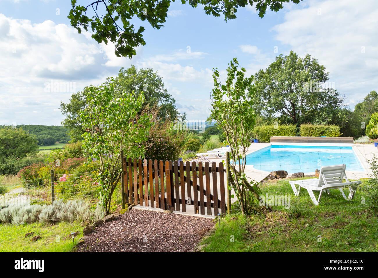 Garden pool chair stock photos garden pool chair stock for Garden pool hanoi