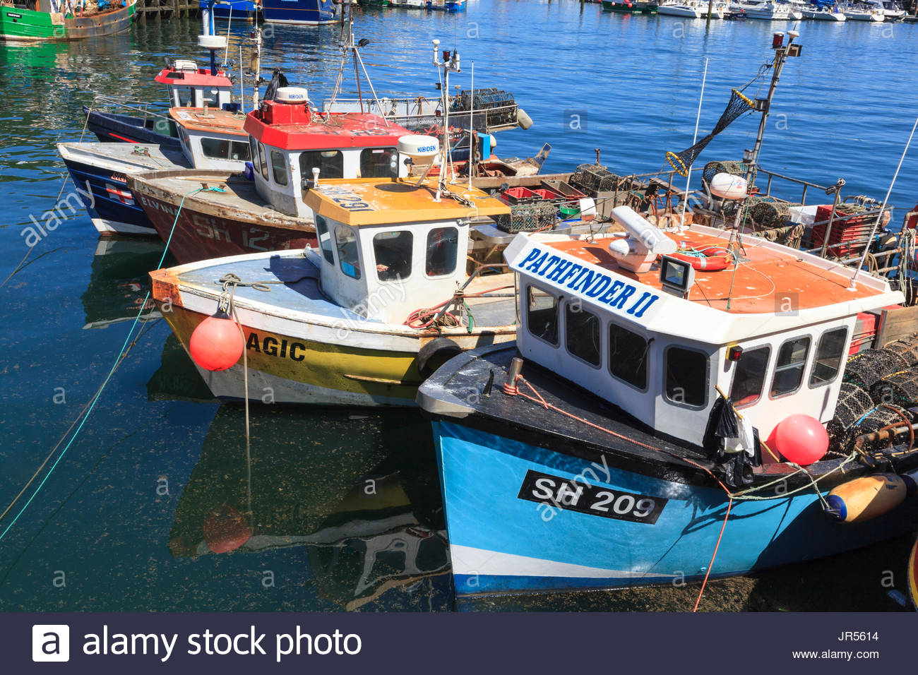 Fishing boats for hire stock photos fishing boats for for Inshore fishing boats