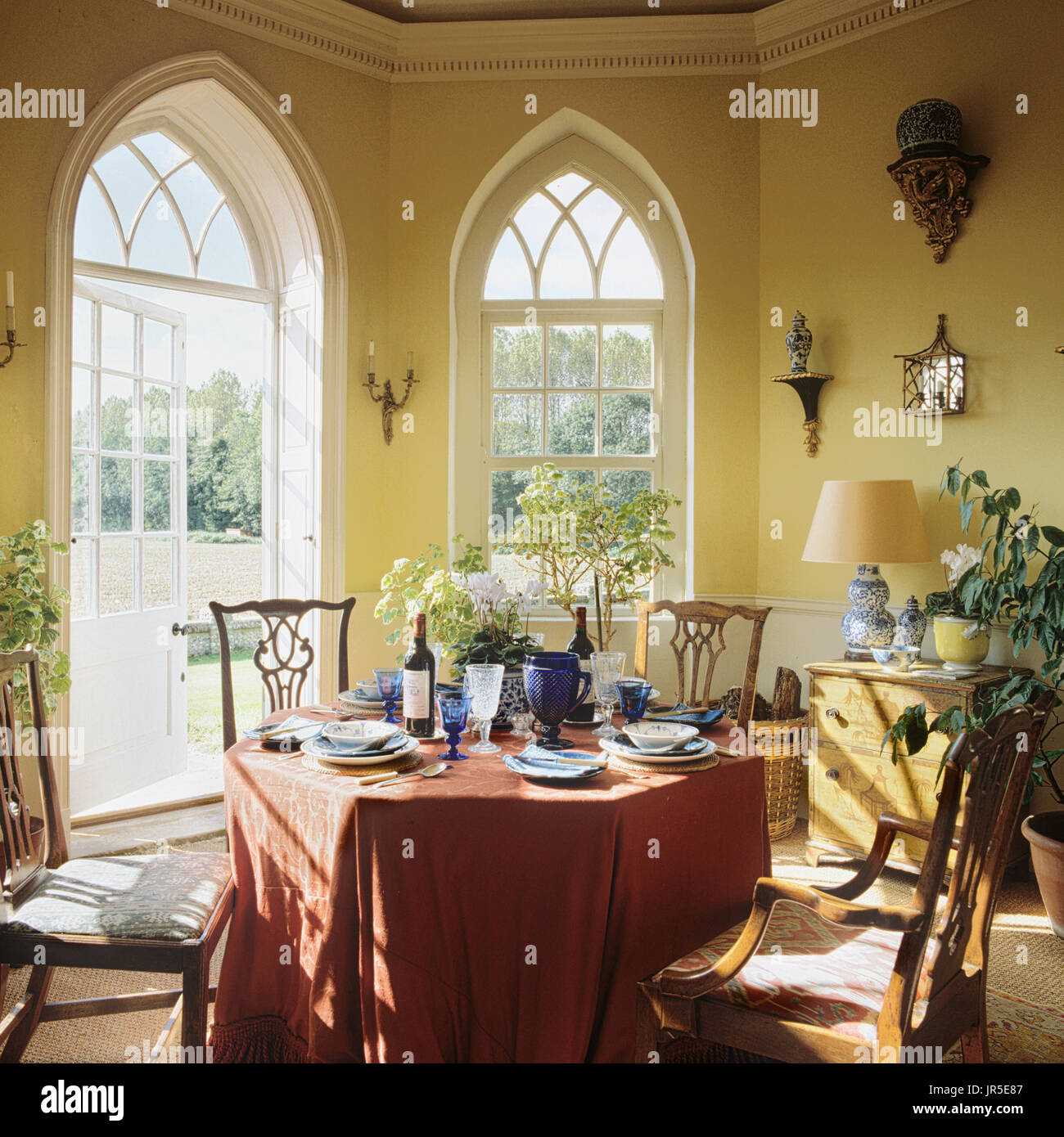 Dining Room With Gothic Style Windows