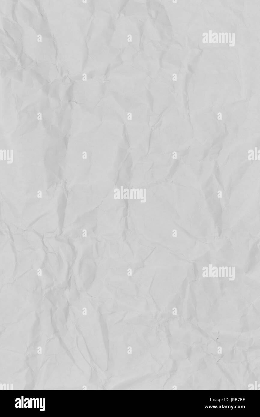 white folded paper background with rough texture stock photo