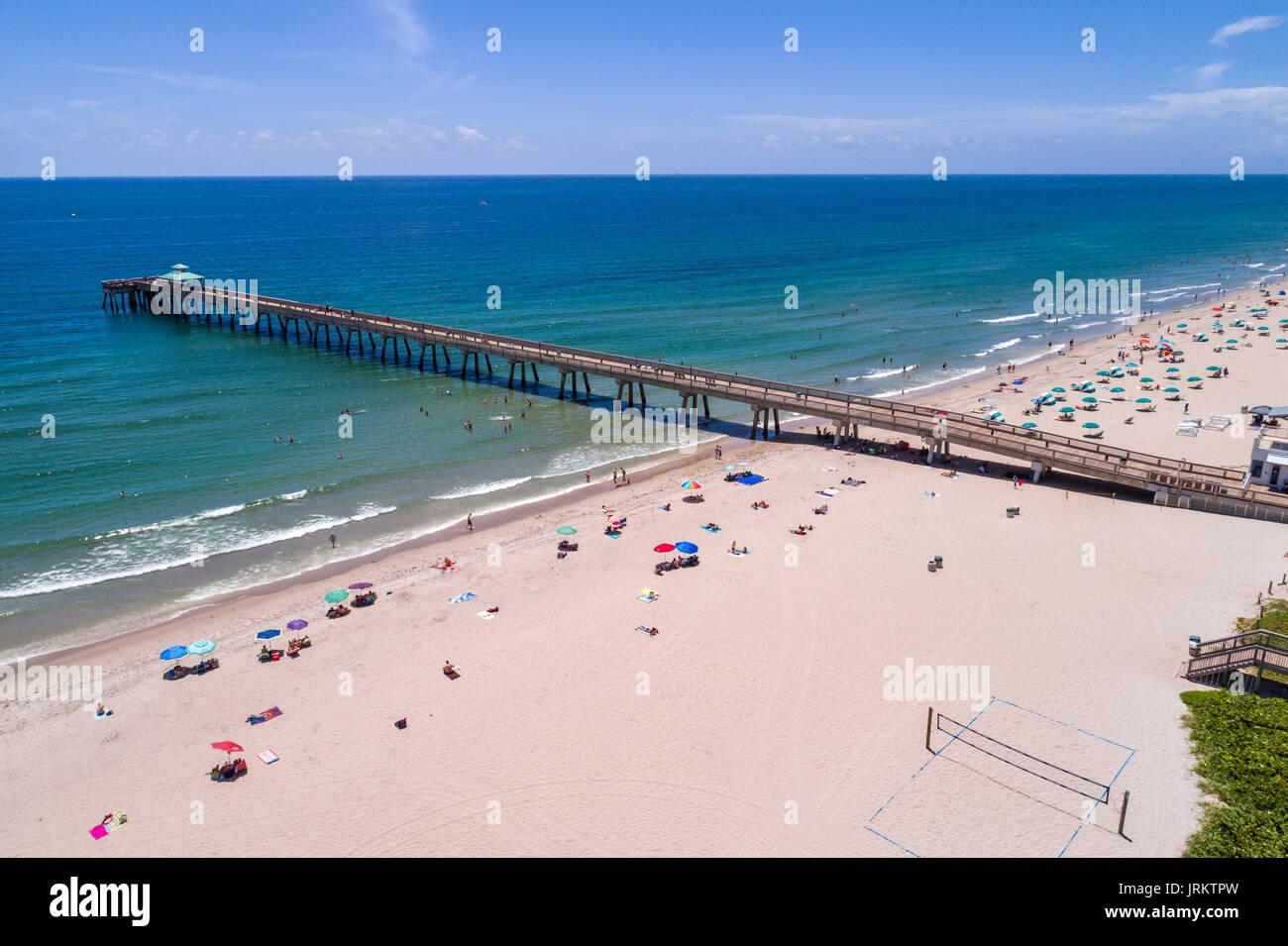 Aerial beach sunbathers stock photos aerial beach for Vero beach fishing pier