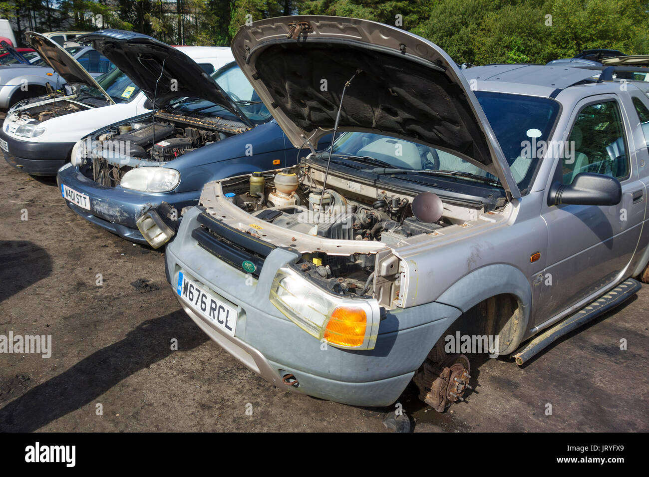 old cars being used for spare parts in a scrapyard Stock Photo ...