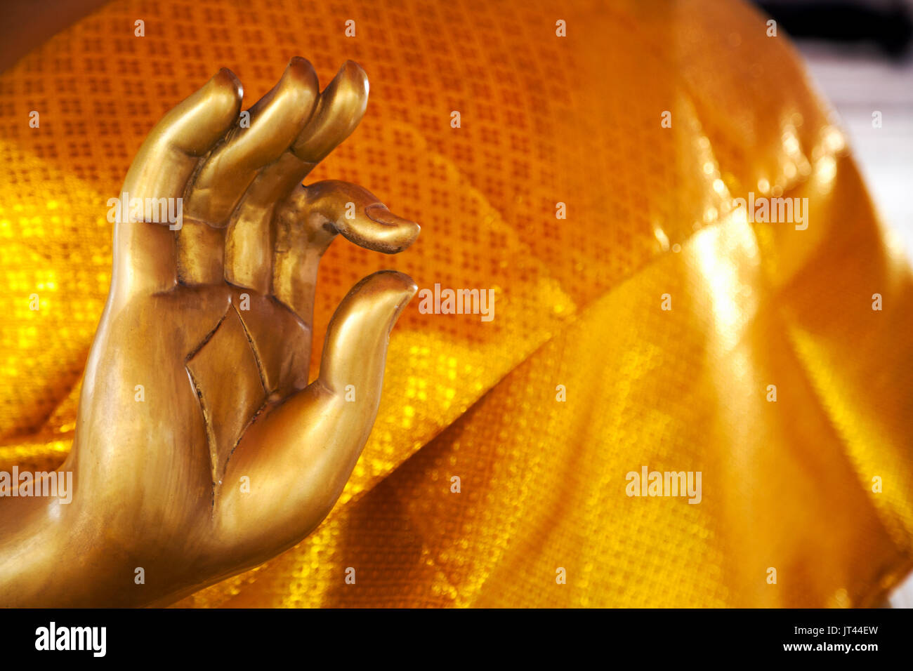 Golden buddha statue hand gesture close up with copy space asian golden buddha statue hand gesture close up with copy space asian symbolic ok mudra thumb and index fingers joined buycottarizona