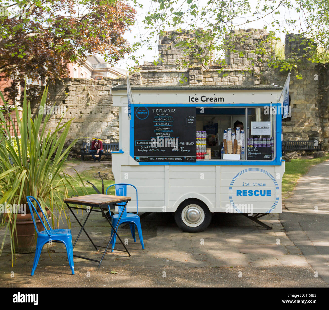 blue and white mobile ice cream van with table and chairs nearby in rh alamy com van with tail lift van with table uk
