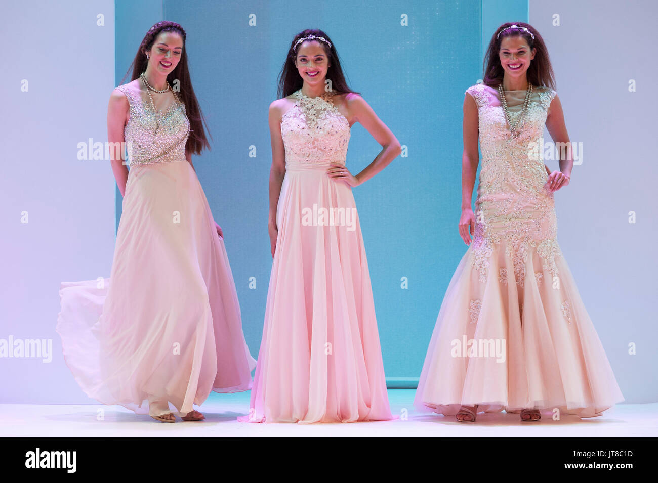 Fashion models wearing prom dresses on the fashion catwalk at Moda ...