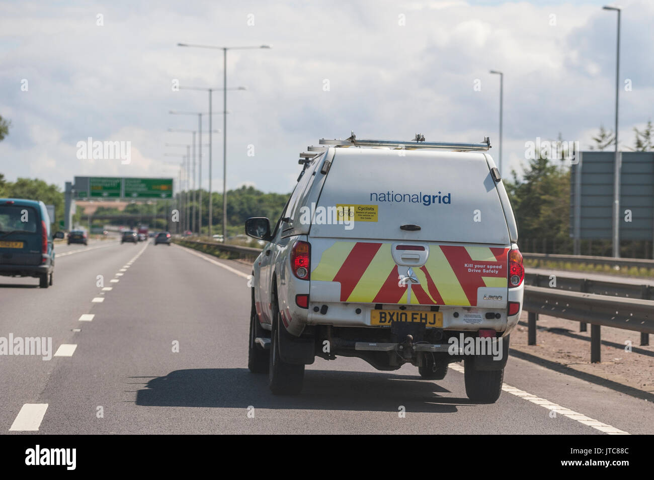 National grid uk stock photos national grid uk stock images alamy a nationalgrid van driving on a main road in the uk stock image biocorpaavc Image collections