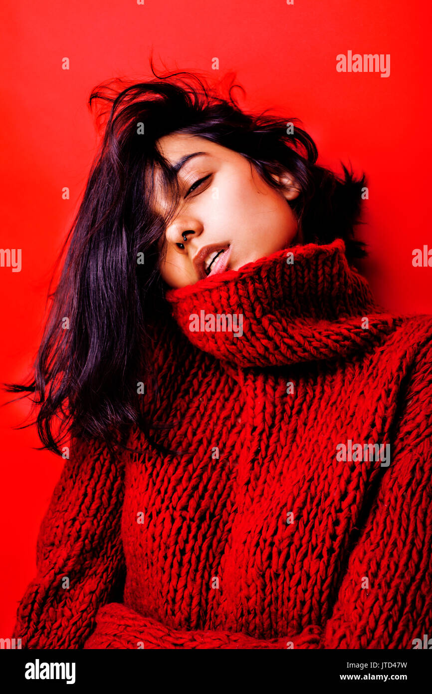 young pretty indian mulatto girl in red sweater posing emotional, fashion  hipster teenage, lifestyle people concept